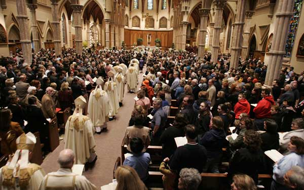 Parishoners mourn the passing of Pope John Paul II during an evening mass at Holy Name Cathedral, Saturday, April 2, 2005, in Chicago. Pope John Paul II died Saturday at his papal apartment at the Vatican in Rome. <span class=meta>( &#40;AP Photo&#47;Brian Kersey&#41; )</span>